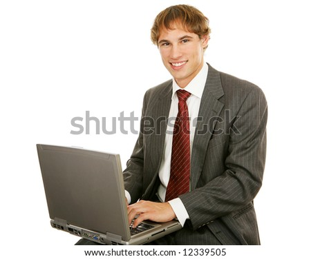 Handsome young businessman typing on his laptop.  Isolated on white. - stock photo