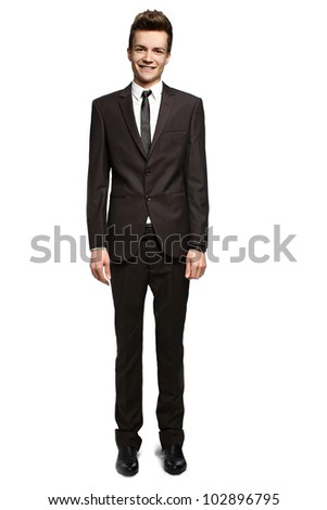 Handsome young businessman with a slight smile on his face - stock photo