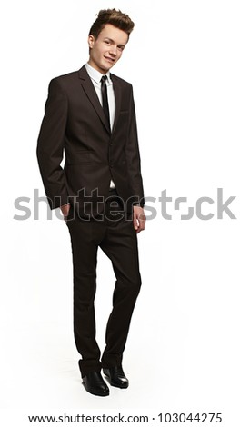 Handsome young businessman with a slight smile on his face