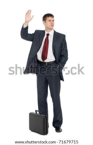 Handsome young businessman with a welcoming gesture. Isolated on white. - stock photo