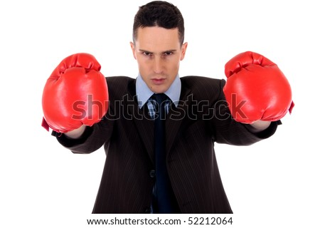 Handsome young businessman with boxing gloves.  Studio white background - stock photo