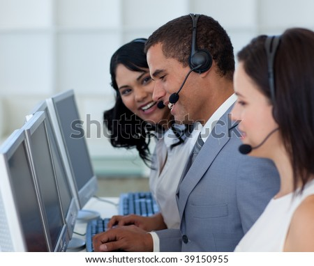 Handsome young businessman working in a call canter