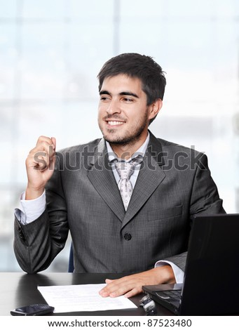 Handsome young businessman working in his office