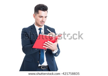 Handsome young businessman writing notes on a notebook or agenda as appointment concept isolated on white - stock photo