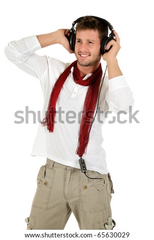 Handsome young caucasian man listening music in headphones. Studio shot. White background. - stock photo