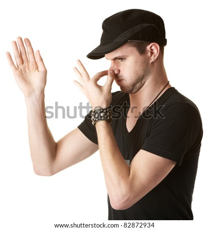 Handsome young Caucasian man pinches his nose over white background - stock photo