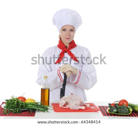 Handsome young chef in uniform prepares chicken. Isolated on white background - stock photo