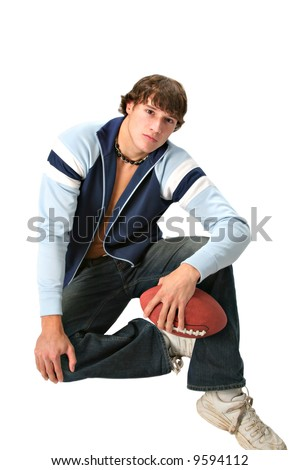 handsome young college student holding football isolated - stock photo