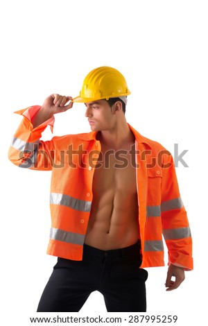 Handsome young construction worker with orange suit open on naked torso, wearing yellow hardhat - stock photo