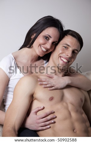 Handsome young couple at home - stock photo
