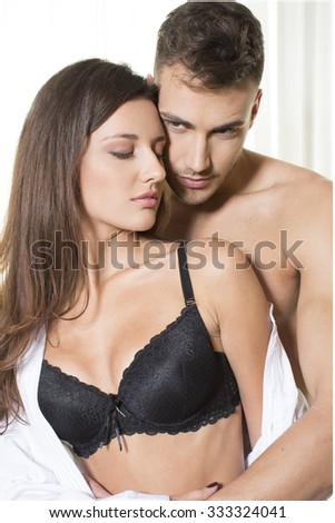 Handsome young couple in love posing in lingerie