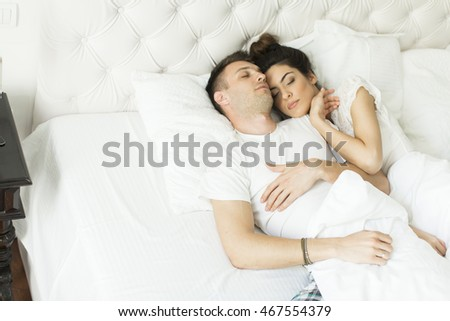 Handsome young couple relaxing in the bed