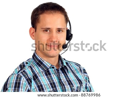 Handsome young customer service employee with headphones on - stock photo