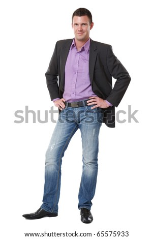 handsome young elegant man standing on white background