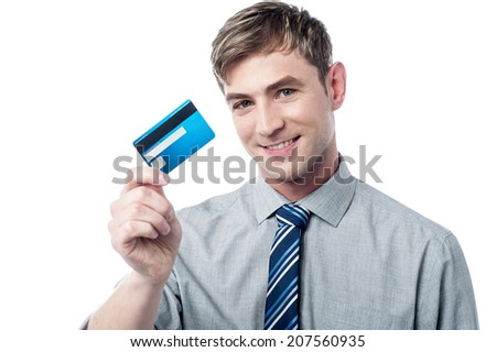 Handsome young executive holding credit card