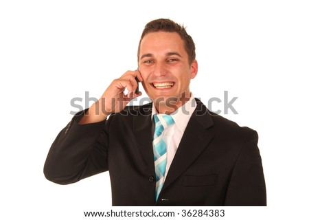 Handsome young executive man talking on mobile telephone