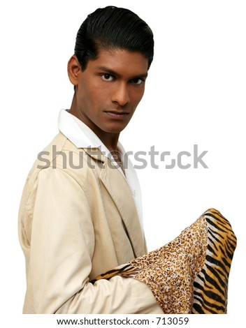 Handsome young exotic man, in cream suit with tiger print throw