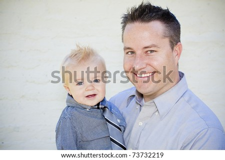 Handsome young father and his cute son portrait - stock photo