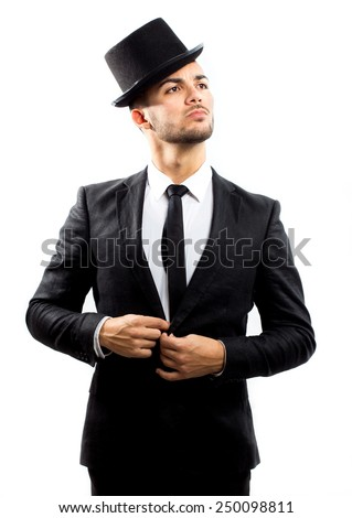 Handsome young gentleman wearing suit and top hat - stock photo