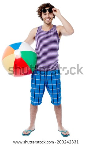 Handsome young guy holding a beach ball - stock photo