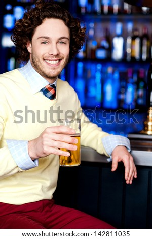 Handsome young guy holding beer glass - stock photo