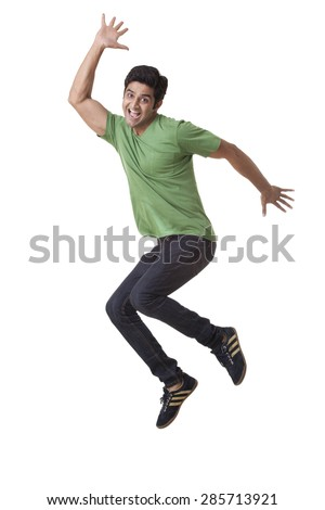 Handsome young guy jumping over white background - stock photo