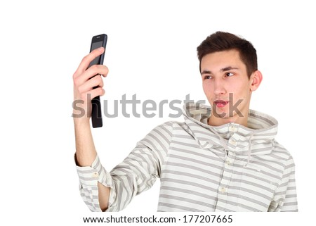 handsome young guy making selfie - stock photo