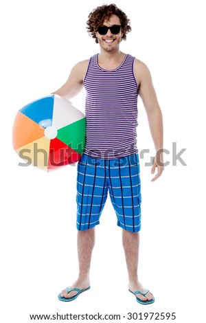 Handsome young guy posing with beach ball - stock photo