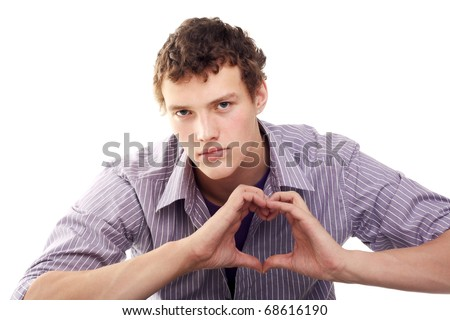 handsome young guy showing the heart sign with his hands - stock photo