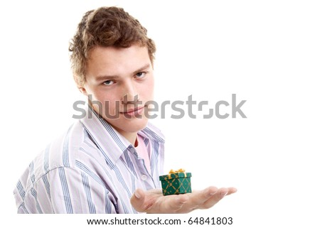 handsome young guy with a little gift - stock photo