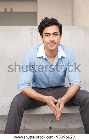 Handsome, young latino businessman