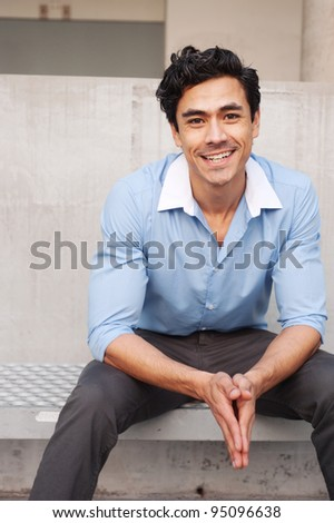 Handsome, young latino businessman - stock photo
