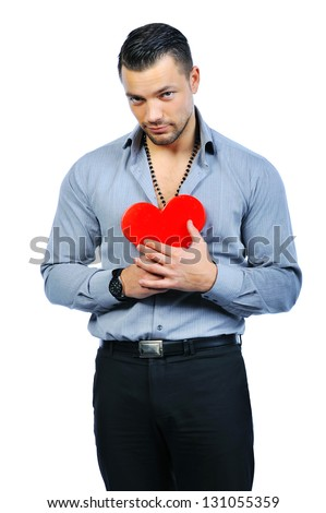 Handsome young macho man holding love heart portrait - isolated on white - stock photo