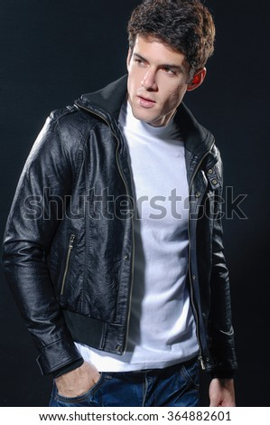 handsome young male-black background - stock photo