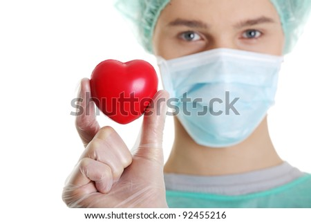 Handsome young male doctor holding heart shape toy, on white - stock photo