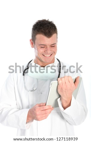 Handsome young male doctor wearing a labcoat and stethoscope smiling in glee at information on his tablet computer isolated on white - stock photo