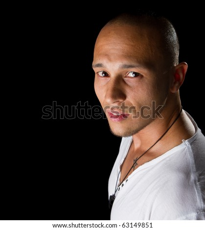 Handsome young male filipino model with white shirt over black background.