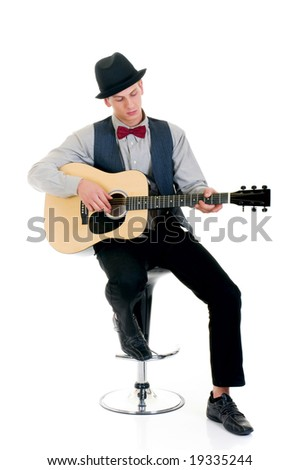 Handsome young male guitar player. Studio shot, white background.