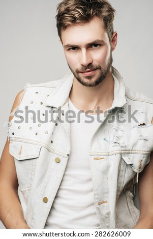 Handsome young male model in the studio - stock photo