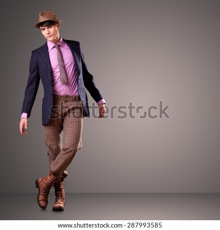 Handsome young male model posing in the studio, clean composition - copy space - stock photo