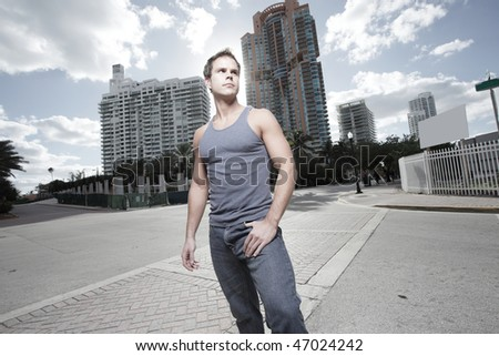 Handsome young male model posing on the street corner