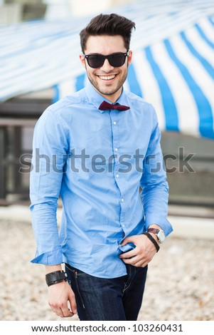 handsome young male smiling dressed casual - outdoor - stock photo
