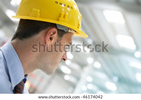 handsome young man architect on a building construction site - stock photo