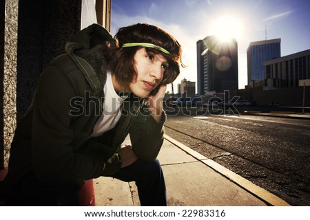 Handsome young man at sundown in an urban setting