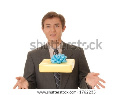 Handsome young man carrying a gift - stock photo