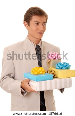 Handsome young man carrying many gifts - stock photo