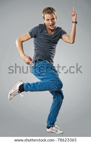 Handsome young man dancing - stock photo
