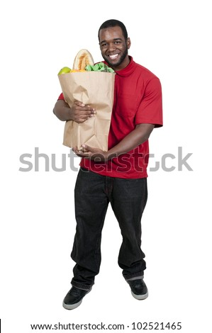 Handsome young man doing his grocery shopping - stock photo