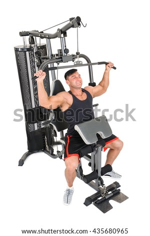 Handsome young man doing lateral pull-down workout isolated on white - stock photo