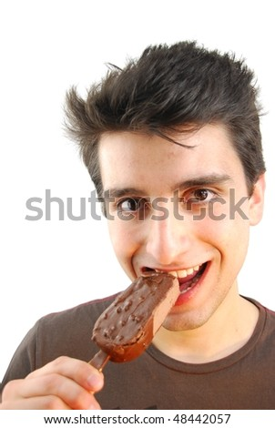 handsome young man eating a chocolate ice-cream isolated on white background - stock photo
